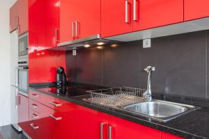 A kitchen or kitchenette at Feel at home - Free private parking