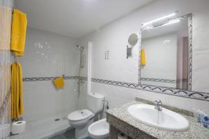 Een badkamer bij Hotel Green Field