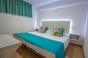 Een bed of bedden in een kamer bij Hotel Green Field