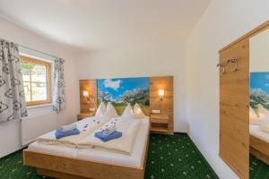 מיטה או מיטות בחדר ב-Apartments Unterfischergut