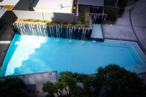 A view of the pool at Circle On Cavill Ocean Views In The Heart of Paradise!!! or nearby