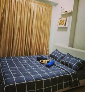 A bed or beds in a room at Sweet Homestay Penang