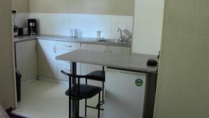 Cuisine ou kitchenette dans l'établissement St Martini Studio apartment