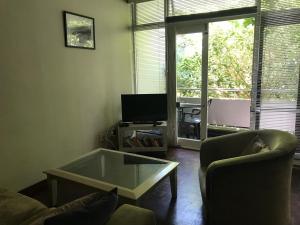 Télévision ou salle de divertissement dans l'établissement St Martini Studio apartment