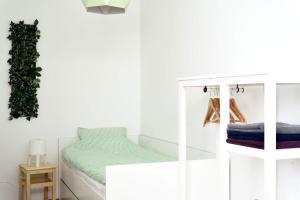 Posteľ alebo postele v izbe v ubytovaní Kofoo Križanićeva Apartment