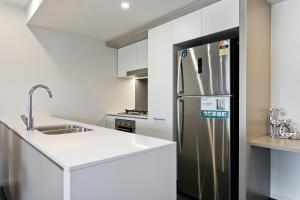 A kitchen or kitchenette at Arise Spice Apartments