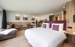 A bed or beds in a room at Vinea - Apartments