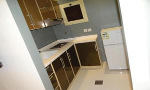 A kitchen or kitchenette at West Liberty