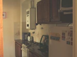 Una cocina o kitchenette en Edificio El Ebro. Dpto 11