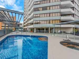 The swimming pool at or near The Astor Apartments