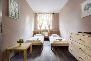 A bed or beds in a room at Premium Family&Friends