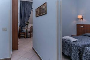 A bed or beds in a room at Residence Lodi