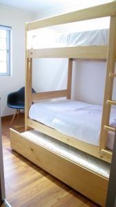 A bunk bed or bunk beds in a room at Eduardo Designer Apartments Miraflores