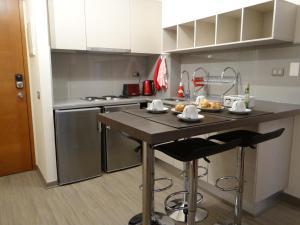 Una cocina o zona de cocina en Nuevo departamento en el corazón de Santiago