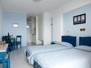 A bed or beds in a room at Ostria Seaside Studios and Apartments