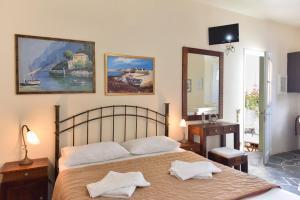Un ou plusieurs lits dans un hébergement de l'établissement Giannakas Studios