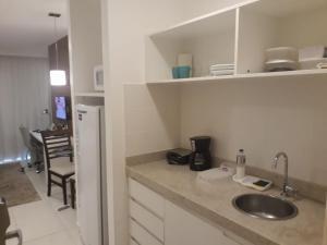 A kitchen or kitchenette at Hotel Fusion Express, Setor Hoteleiro Norte