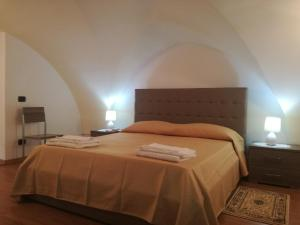 A bed or beds in a room at Dimora Rudiae Casa Vacanze