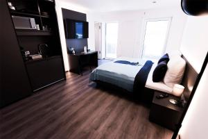 A bed or beds in a room at Mood contemporary living