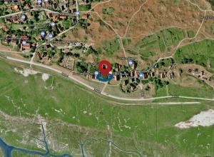 Blick auf Haus an den Salzwiesen - Wohnung Lachmöwe aus der Vogelperspektive