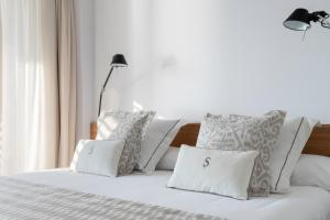 A bed or beds in a room at Pure Salt Residences