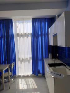 Телевизор и/или развлекательный центр в Квартира в Олимпийском парке
