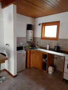 Una cocina o kitchenette en 845 Teniente Ramayón