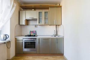 A kitchen or kitchenette at 2 rooms apartment