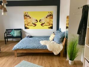 A bed or beds in a room at 5 Zimmer Loftstylewohnung in Bad Wörishofen