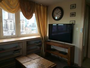 Telewizja i/lub zestaw kina domowego w obiekcie Amica Apartment by WarsawResidence Group