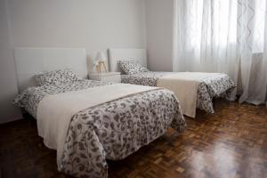 Cama o camas de una habitación en Apartamento con encanto y bien ubicado
