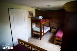 Una cama o camas cuchetas en una habitación  de Complejo Sur Azul
