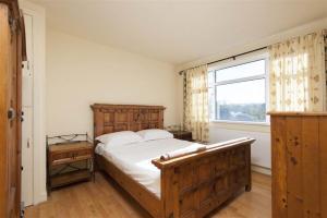 Cama o camas de una habitación en The Hack Self Catering Apartment