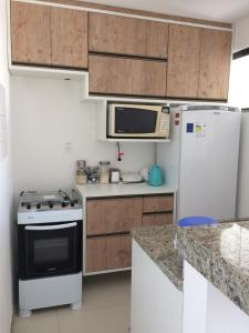 A cozinha ou cozinha compacta de Solaris Village