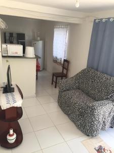 Zona de estar de Casa na Vila do Chicão