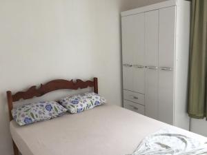 Cama o camas de una habitación en Casa na Vila do Chicão