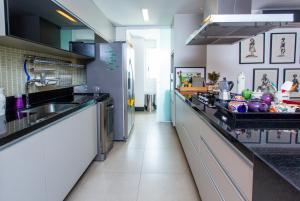 Una cocina o zona de cocina en Aconchego com Bossa