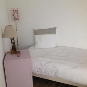 Un ou plusieurs lits dans un hébergement de l'établissement Villa des Sarcelles