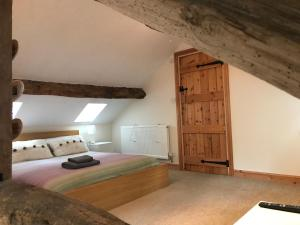 A bed or beds in a room at The Stables