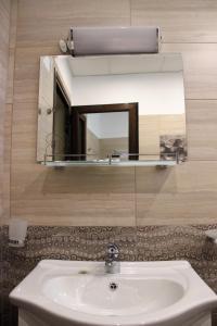 A bathroom at Rupchini Houses