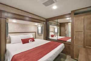 A bed or beds in a room at Sunshine Key King Travel Trailer 5