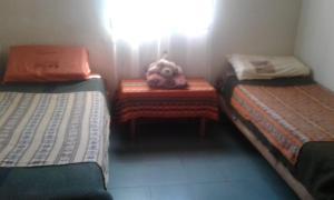 Una cama o camas en una habitación de La Casa de Tito