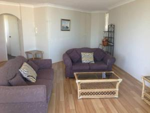 A seating area at Beachpoint, Unit 101, 28 North Street