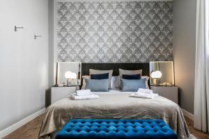 Uma cama ou camas num quarto em Gloria Suites by LxWay