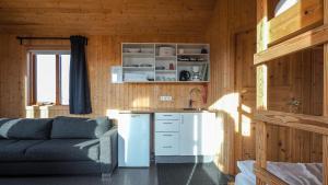 A kitchen or kitchenette at Hvammstangi Cottages