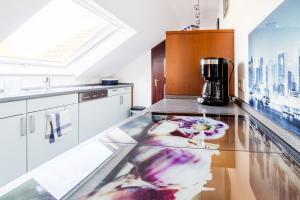Kuchyň nebo kuchyňský kout v ubytování Ferienwohnung Konrad Duden