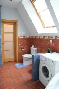 Vonios kambarys apgyvendinimo įstaigoje Apartamentai Luna