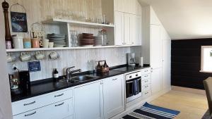 Ett kök eller pentry på Villa Leksand