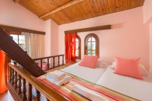 A bed or beds in a room at Villas Marianna