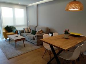 A seating area at Apt Moderno céntrico y soleado